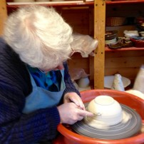 Gail Kelly trims a leather hard bowl