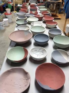 Glazed bowls ready for the kiln