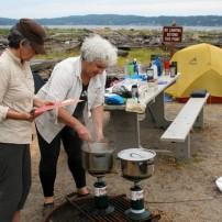 Leader Maria Cook and Jane Trancho prepare breakfast.