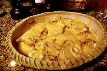 Scalloped potatoes topped with cheese, hot from the microwave and ready to serve!