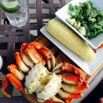 Enjoy local flavors in the summer, like Dungeness crab and corn on the cob.