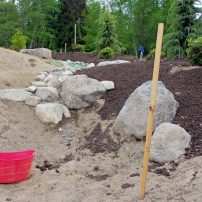 Bosley's second rain garden is seen here under construction.