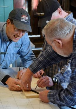 Gig Harbor BoatShop - Boatwright Tom Regan, left, shares his expertise as part of the community boat-restoration program.