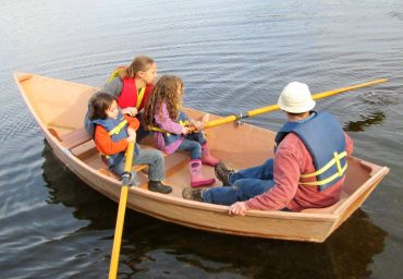 Gig Harbor BoatShop - A family enjoys a boat they built as part of the family boatbuilding program.