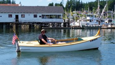 A.R. Fisk, an electric launch restored through the community boat-restoration program, is available to the public for rent.