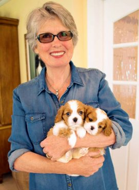 Barbara shows off two puppies.