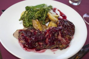 Morso Roasted duck breast with grilled berries in a port wine reduction