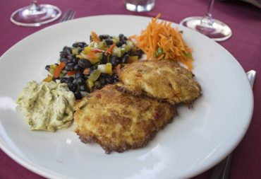 Morso Crab cakes with fiesta black beans and carrot slaw