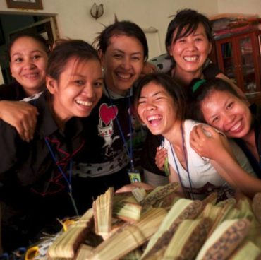An artisan is a worker in a skilled trade, especially one that involves making things by hand. Pictured here are women at the Rajana Association, a nonprofit organization that trains young Cambodians in traditional craft-making skills, as well as accounting, marketing, computer courses and English. Through development of traditional craft-making skills, Rajana helps maintain and rebuild Cambodia's rich cultural traditions, damaged in the country's wars.
