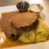 Certified Angus prime rib roast, real beef broth au jus, garlic mashed potatoes, horsy cream