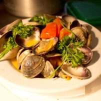 Spicy Allyn Bay clams with garlic butter, white wine and Roma flakes