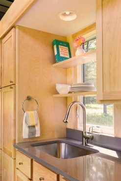 ESCAPE Traveler kitchen pictured with oak cabinets. Cherry or maple cabinets are an available option.