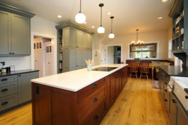 Greatly increased counterspace and accessible storage was achieved in the island and perimeter cabinetry.