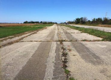 Much of the road is rough and uncared for, like this patch in Illinois.