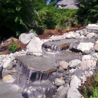 Waterfall installation by Full Throttle Landscaping, using a variety of a variety of flat and round stone from Morrison Gravel (Photo courtesy Mark Stolz)