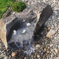 A drilled stone from Morrison Gravel is used by Richard Hedahl for a fountain installation. (Photo courtesy Richard Hedahl)