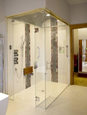 The zero-threshold steam shower is accented with a series of ceramic-and-glass tiles. The barrel-vaulted ceiling is tiled in 1-inch glass mosaic tiles and a bedazzled, glow-in-the-dark grout.