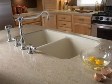 Solid-surface kitchen counter with integral sink in Tumbleweed by Corian (Photo courtesy Dupon)
