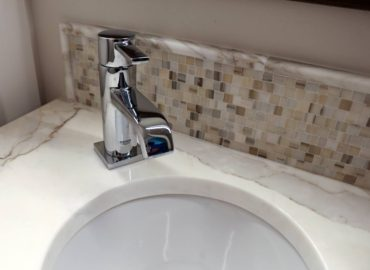 Quarried stone — Calacatta marble vanity counter (Photo courtesy A Kitchen That Works LLC)