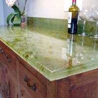 Evolution Glass countertop — clear glass with brown and green accents (Photo courtesy Heather Phillips)