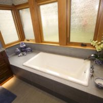 Expansive master bath features tub, extended shower and plenty of storage.
