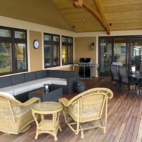 A large covered deck is perfect for outdoor entertaining in the northwest