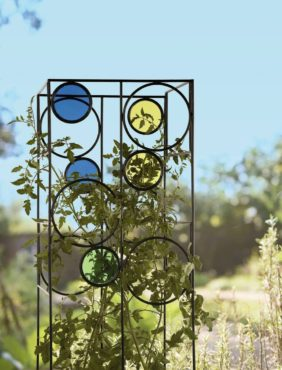 The Kaleidoscope Tomato Cage provides a sturdy support for tomato plants while adding color to the landscape. (Photo courtesy Gardener's Supply Company)