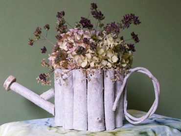 Hydrangea, Verbena bonariensis and persicaria flowers in a basket made of whitewashed branches