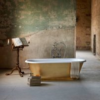 An example of personal space — Tamar gold leaf tub by Drummonds