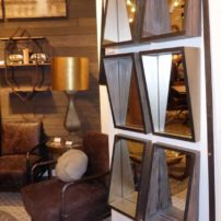 Metal mirror frames with metal framed chair by Mercana