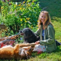 Every gardener should have at least one furry companion in the garden. Two are even better! (The author with her friends)