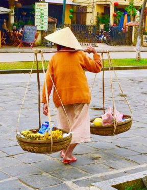 Vietnamese woman with shoulder pole