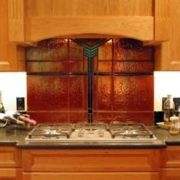 Decorative glass backsplash by Mesolini Glass Studio