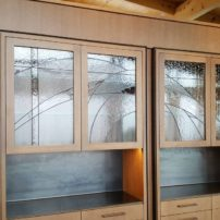 Decorative glass cabinet doors — design by Mark Olson of Unique Art Glass (Photo courtesy Terry Miller)