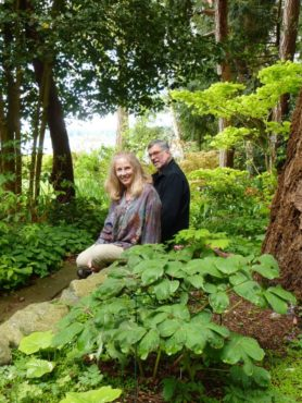 Joanne and Chuck Little sitting in the shade-land garden