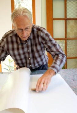 Randy Calm works on a client's design.­