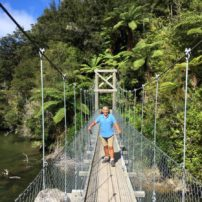 Suspension bridge crossing at Sandfly Bay
