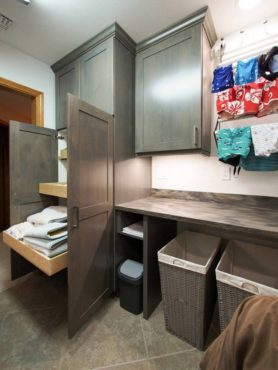 Linen storage, folding space and drying racks were key criteria for this laundry room remodel.