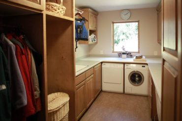 This multitasking laundry room, overlooking the garden, has space for laundry, flower arranging, gift wrapping and more.