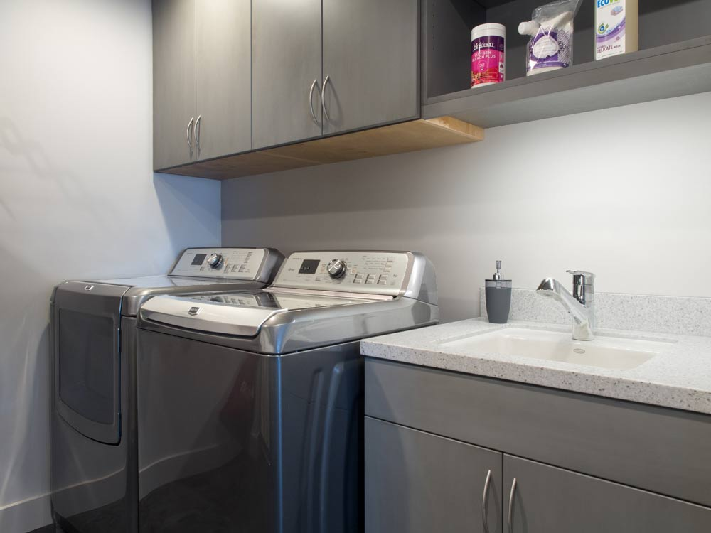 set high to clear the washer door these laundry room wall cabinets were made deep for