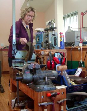 Tenenbaum has an extensive selection of tools and reference materials in her workshop. (Photo courtesy Charlee Glock-Jackson)