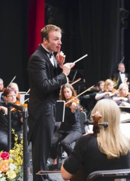Bainbridge Symphony Orchestra music director and conductor Wes Schulz