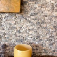 The first project was the fireplace, made of tiny, mosaic, broken-faced stone from floor to ceiling.