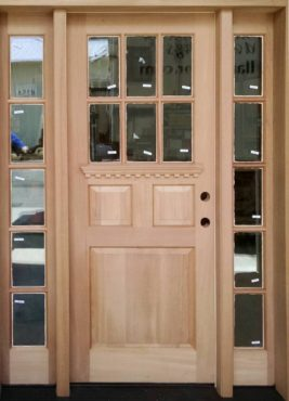 Custom farm-style Spanish cedar front door and sidelights