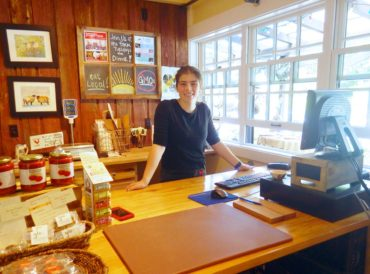 Annika Thornburg greets visitors with a friendly face in the farm store.