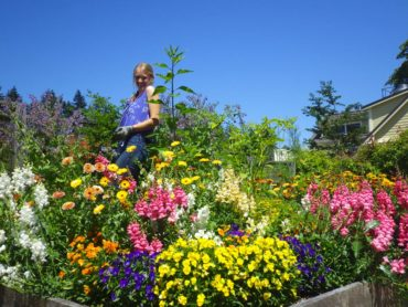 """Jane-of-all-trades"" Meg Herndon tends flowers in the kitchen garden."