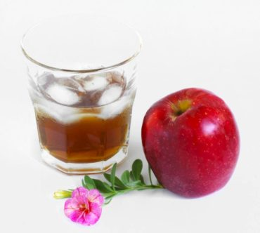 Caramel apple liqueur on the rocks has a luxurious flavor and is made from your apple harvest.