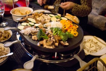 A beautiful variety of veggies/meals can be grilled together at the same time on the raclette top.