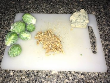 Sliced sprouts and shopped walnuts and blue cheese