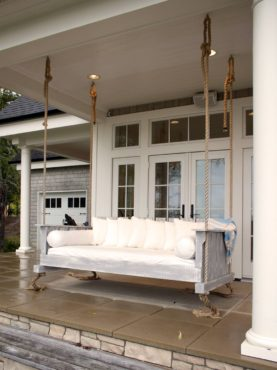 A family favorite — the outdoors swinging bed on the water side